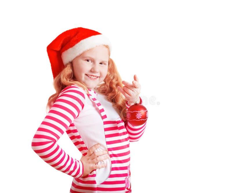 Menina feliz vestida no chapéu de Santa Claus imagem de stock royalty free