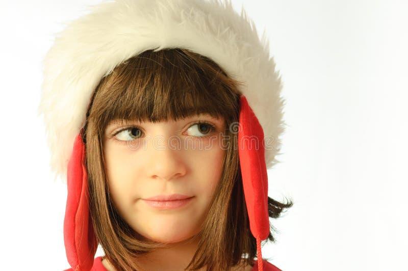 A menina furou com um chapéu de Papai Noel imagem de stock