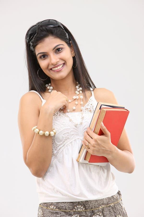 menina glamoroso com livros imagens de stock royalty free