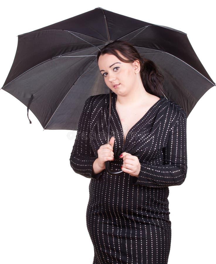 Menina gorda com guarda-chuva fotos de stock