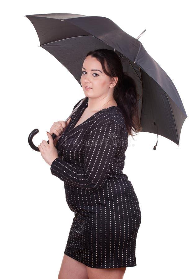 Menina gorda com guarda-chuva fotografia de stock
