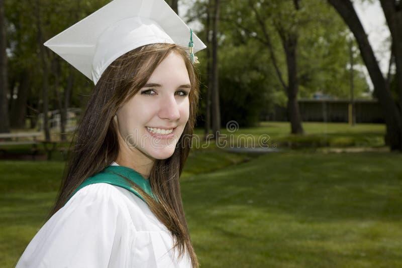 Menina graduada de sorriso fotos de stock