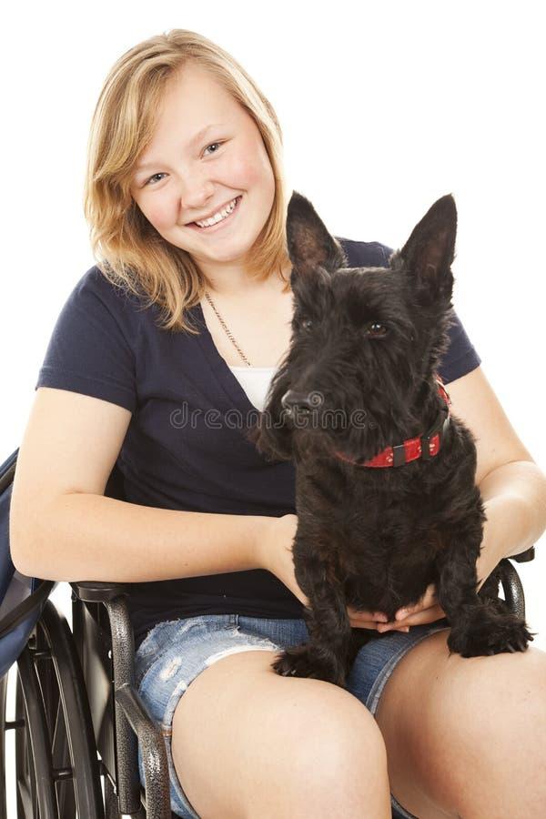 Menina incapacitada com cão imagem de stock royalty free