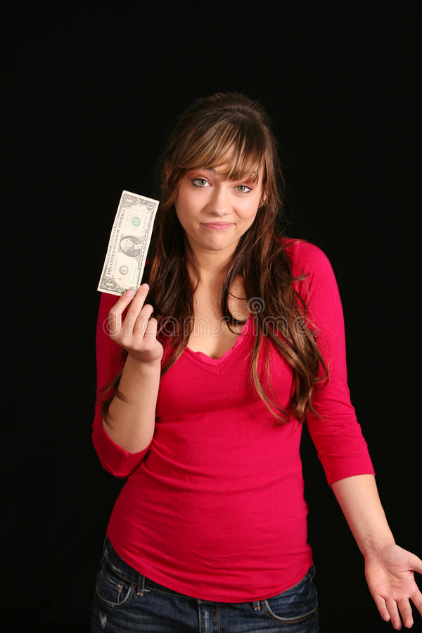 Menina infeliz com conta de dólar foto de stock