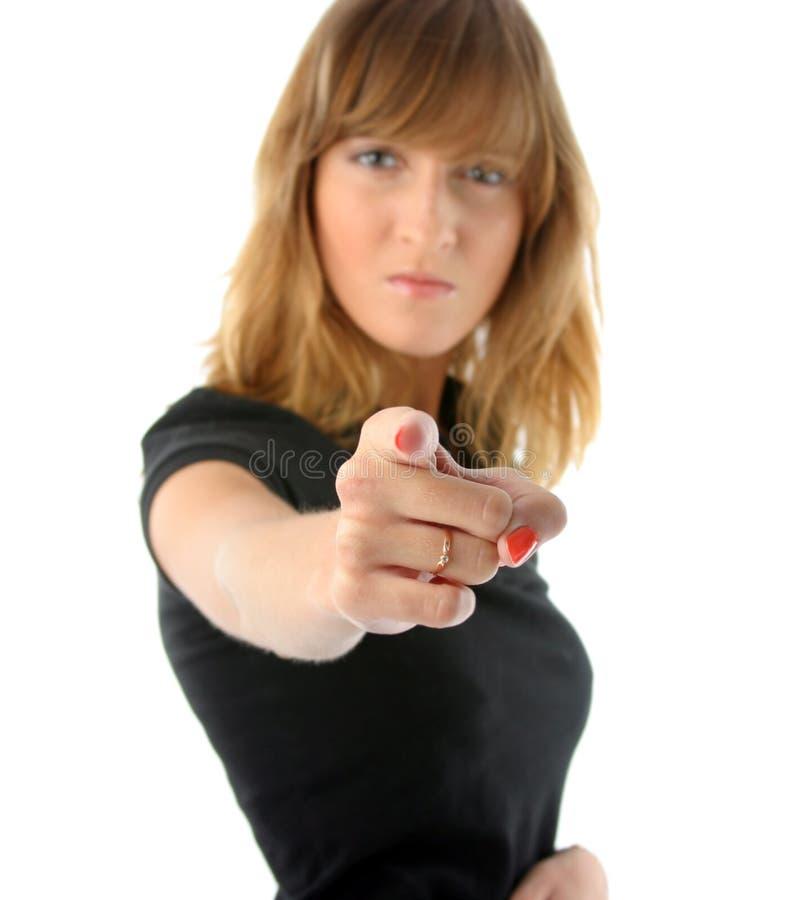 A menina irritada aponta seu dedo imagem de stock