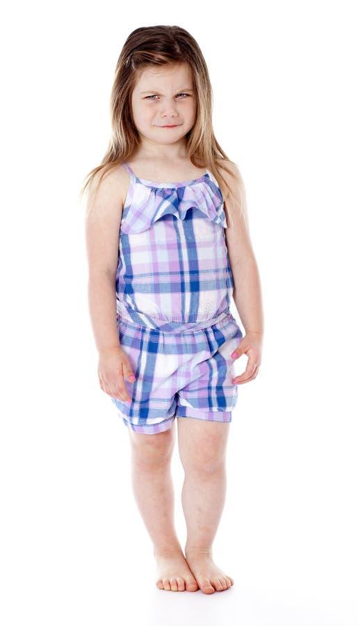 Menina irritada consideravelmente nova isolada no branco fotos de stock royalty free