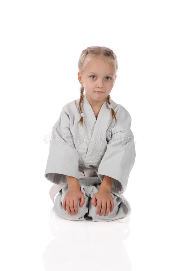 Menina - karateka no quimono imagem de stock