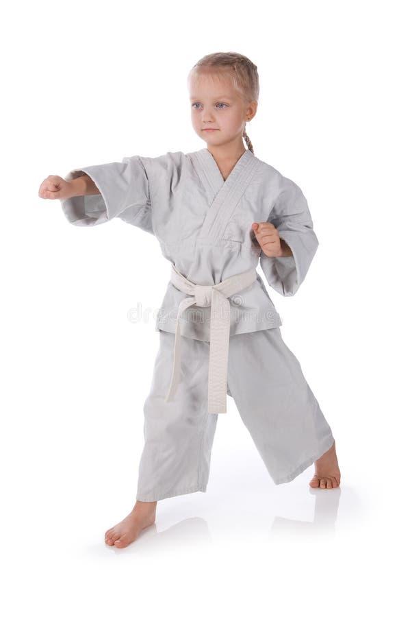 Menina - karateka no quimono foto de stock royalty free