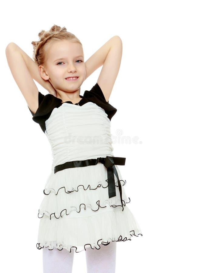 A menina lançada sobre as mãos principais fotos de stock royalty free