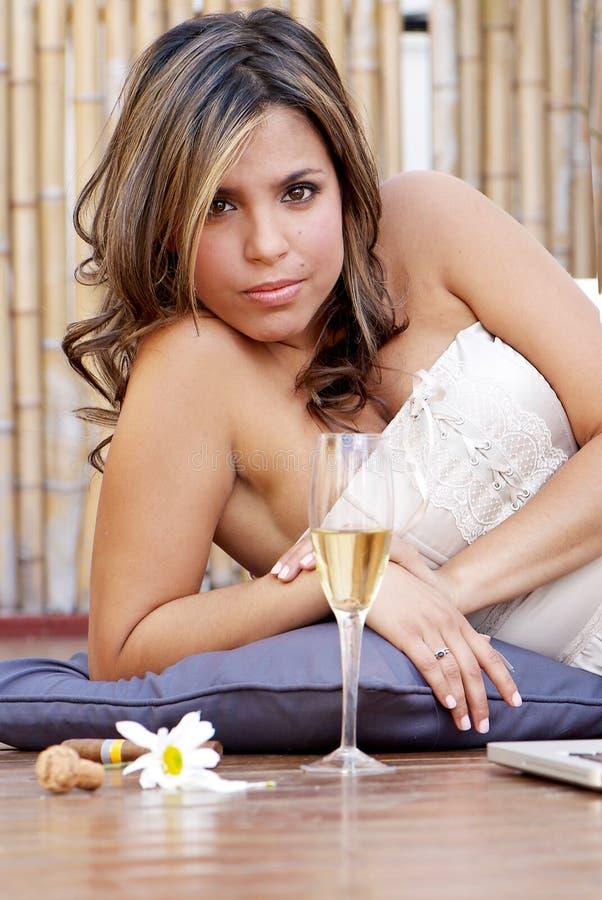 Menina Latin só com champanhe foto de stock royalty free