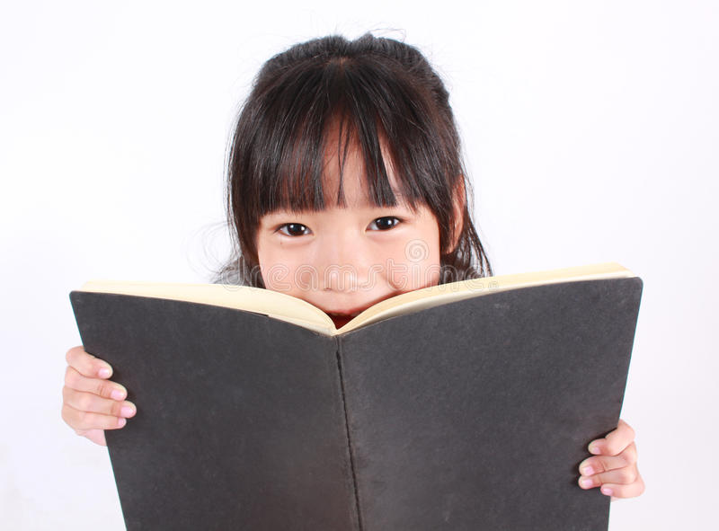 A menina leu o livro imagem de stock