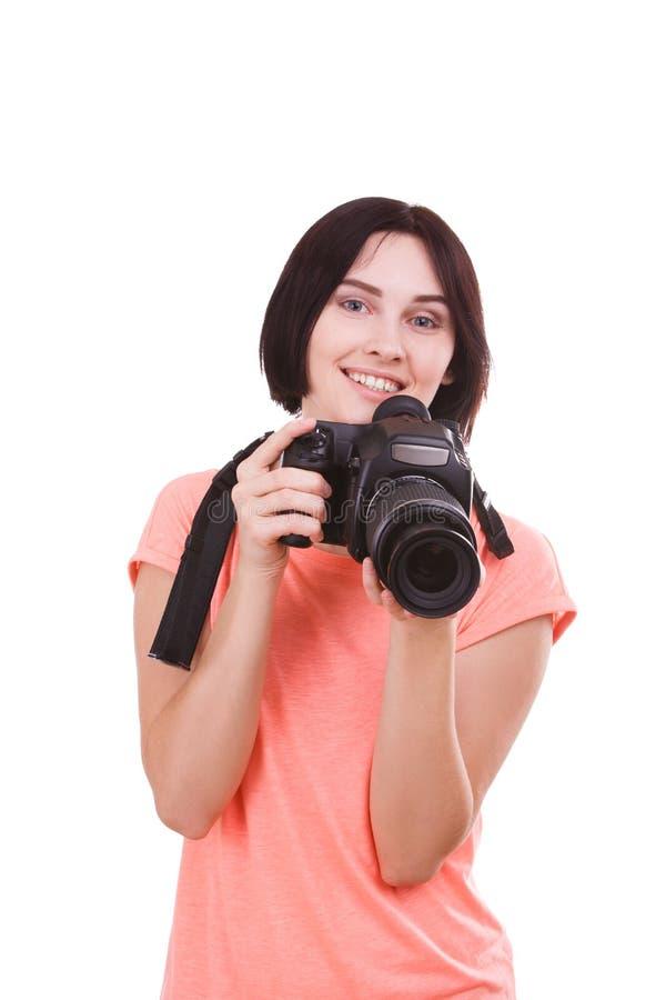 A menina limpou a câmera da cara em um fundo branco foto de stock royalty free