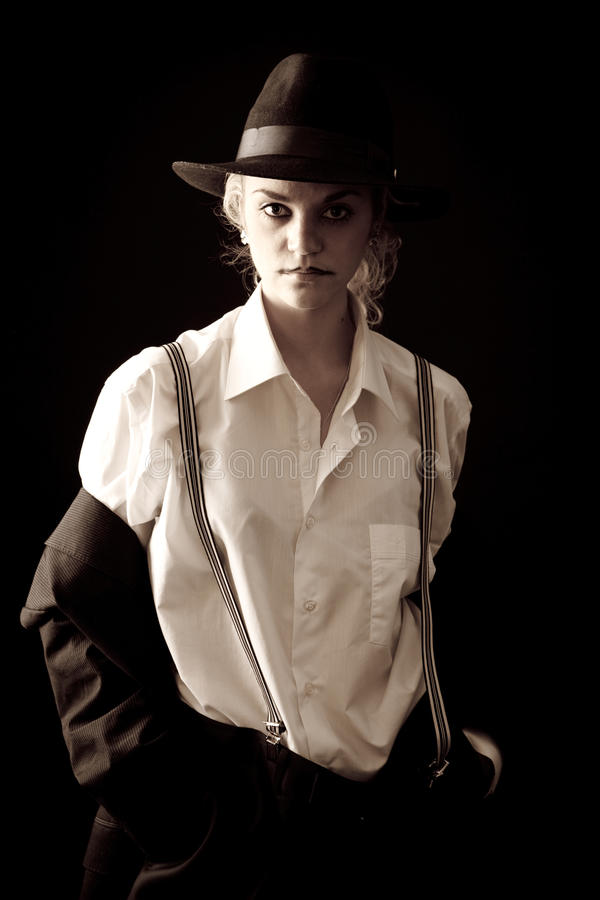 Menina loura bonita no terno e no chapéu fotografia de stock royalty free