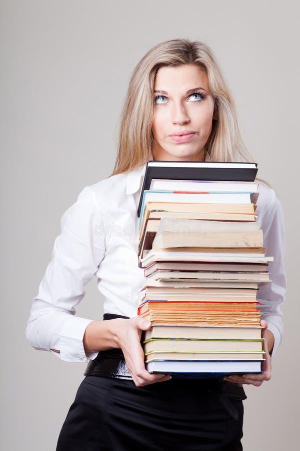 Menina loura com livros fotografia de stock