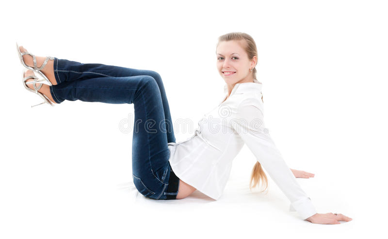 Menina loura de assento foto de stock