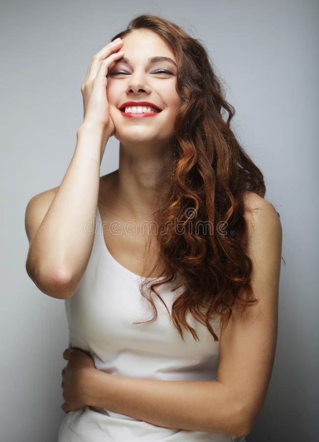 Menina loura de sorriso bonito nova imagem de stock royalty free