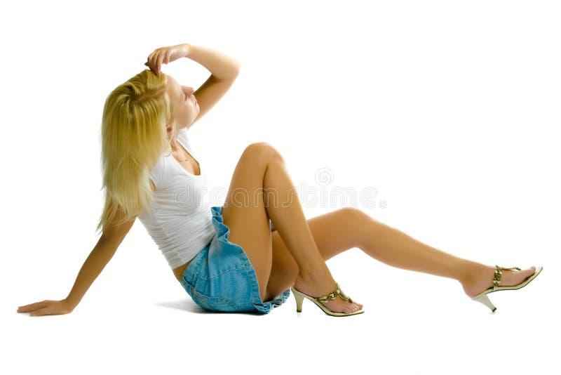 Menina loura no fundo branco imagem de stock