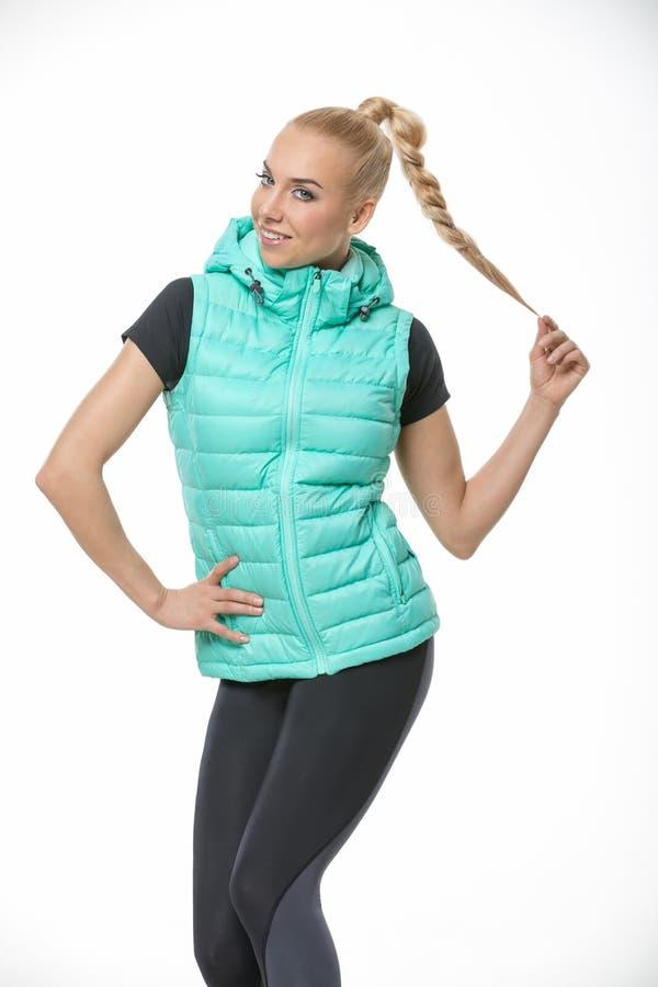 Menina loura no sportswear fotografia de stock