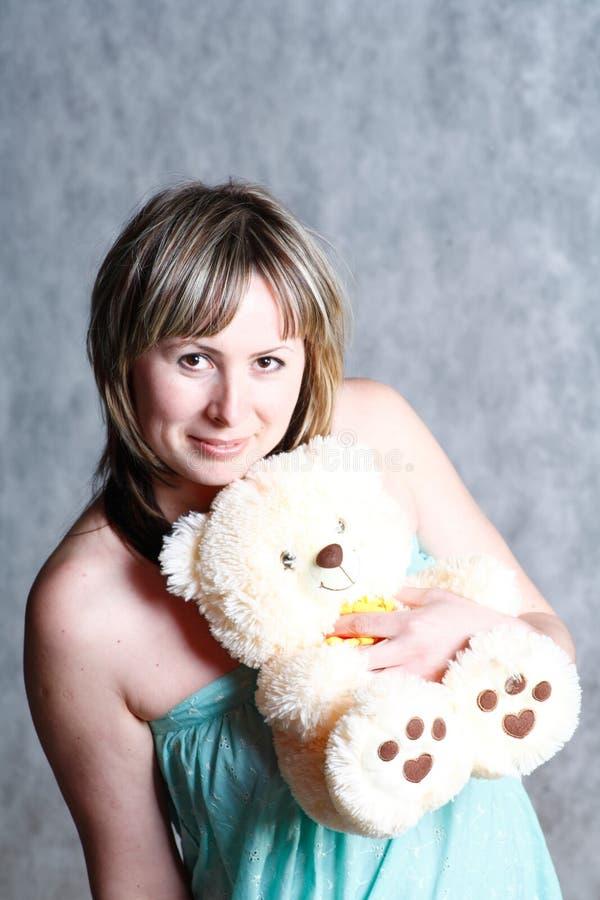Menina loura 'sexy' com urso de peluche fotografia de stock royalty free