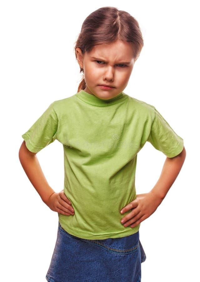 A menina má das crianças irritadas mostra a experimentação dos punhos foto de stock