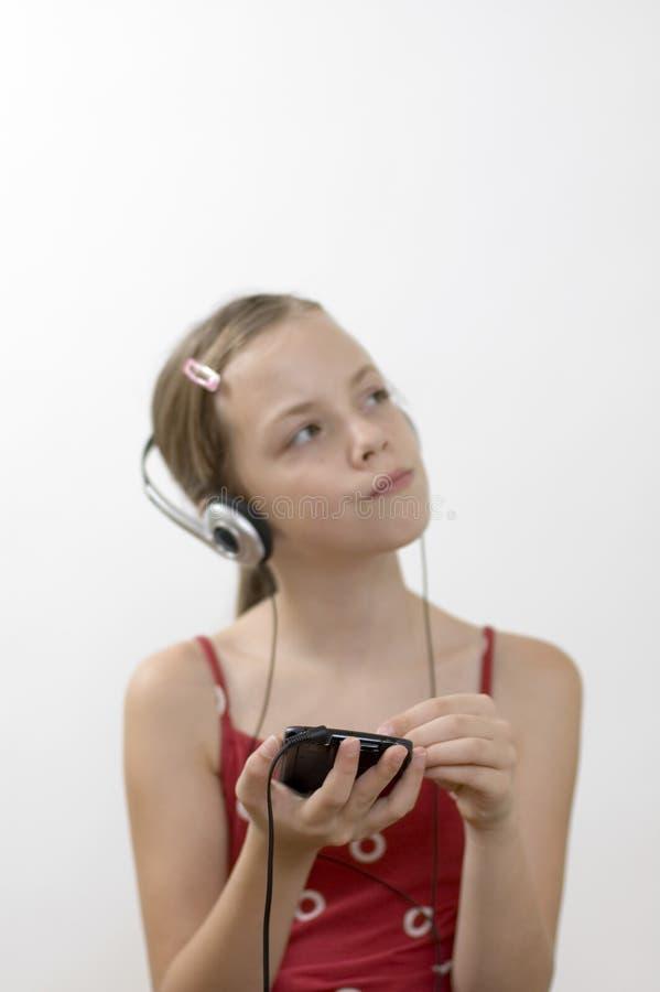 Menina/música/branco imagens de stock royalty free