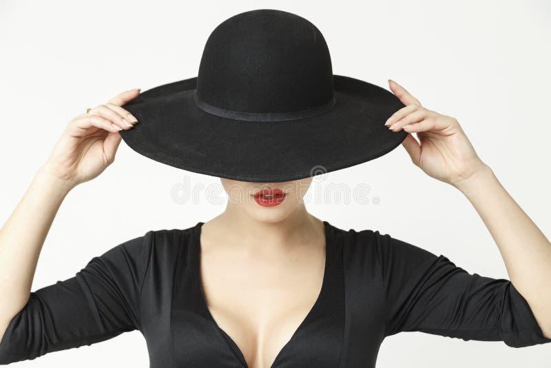 Menina misteriosa em um chapéu imagem de stock royalty free