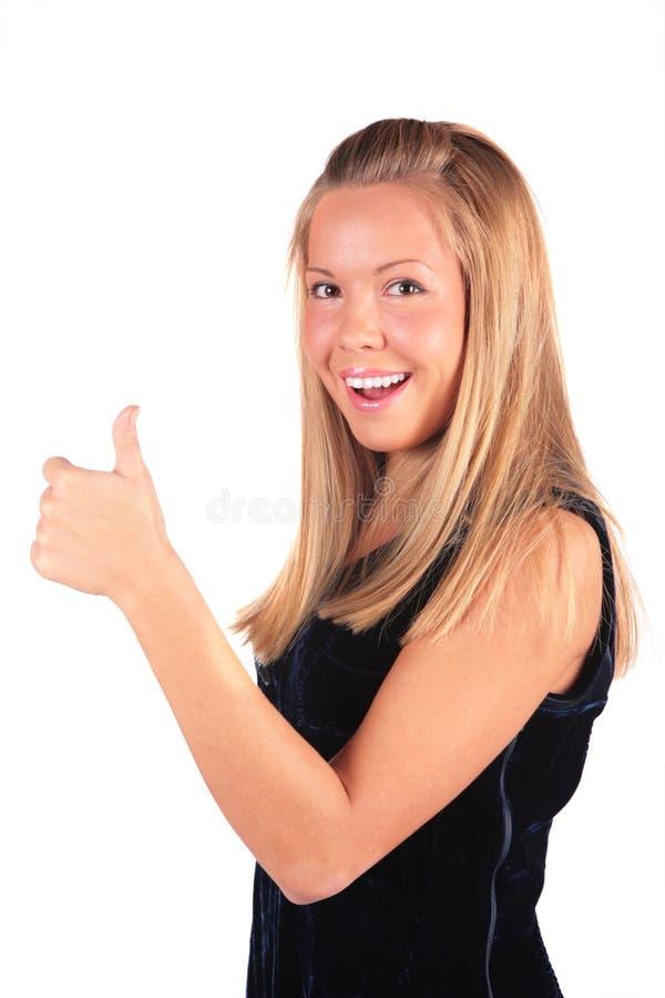 A menina mostra a aprovação do gesto foto de stock