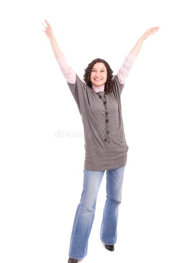 A menina muito feliz com braços levantou fotografia de stock