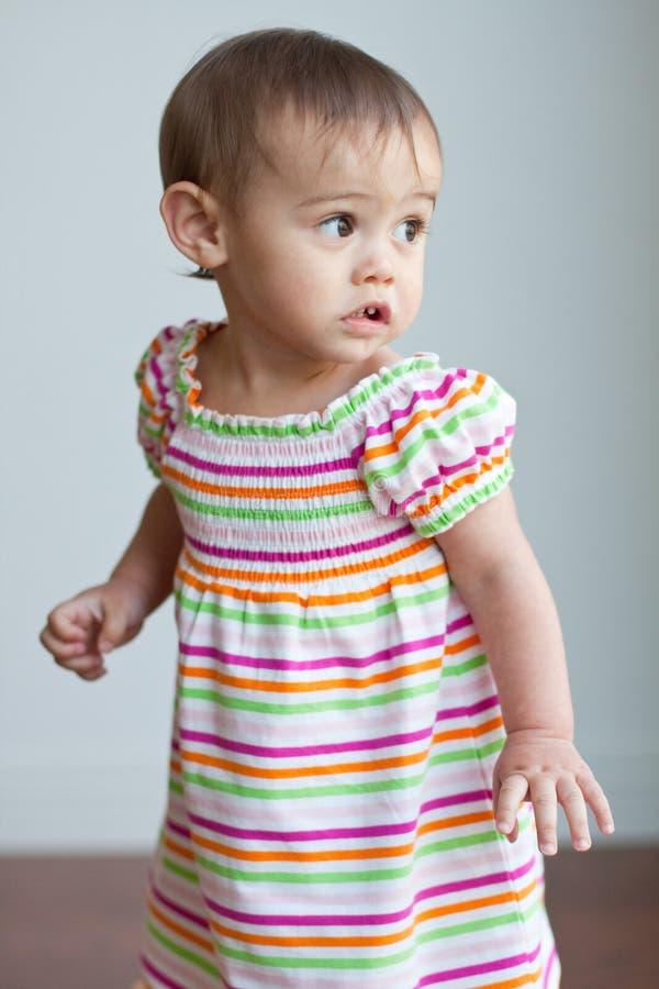 Menina multicultural da criança no vestido bonito imagens de stock