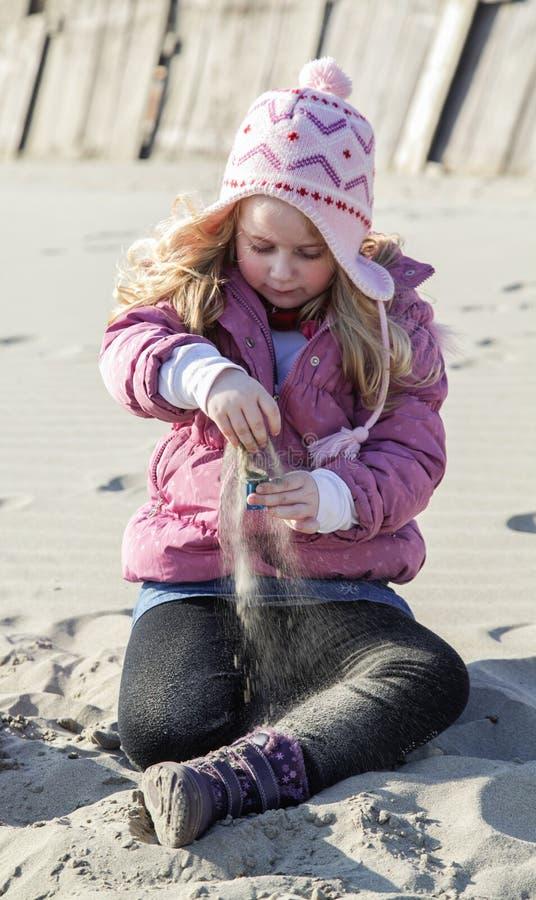 Menina na areia imagens de stock royalty free
