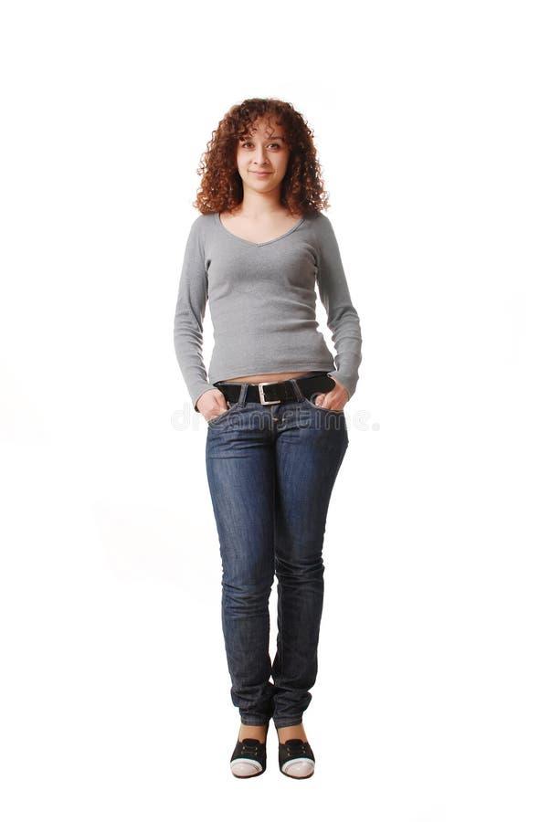 Menina na calças de ganga foto de stock royalty free