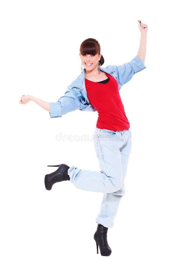 A menina na calças de ganga está dançando imagem de stock