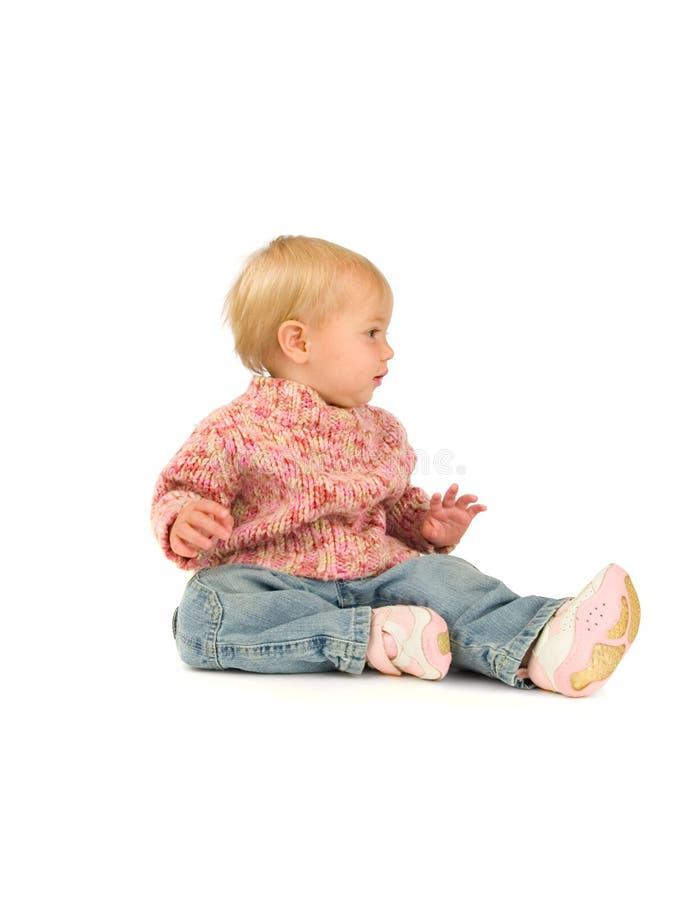 Menina na camisola cor-de-rosa imagem de stock royalty free