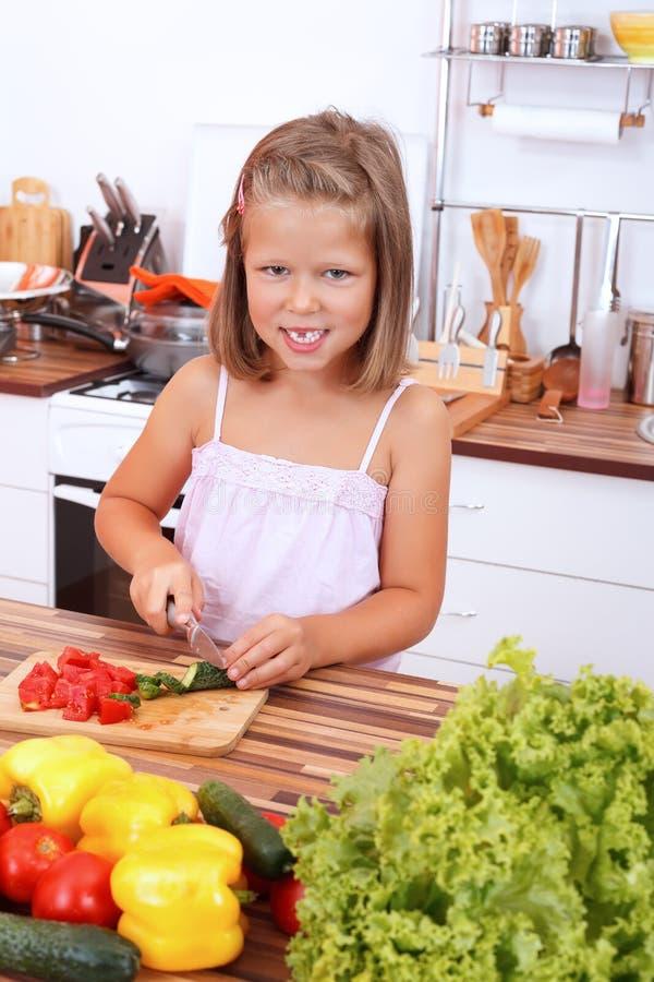 Menina na cozinha imagem de stock