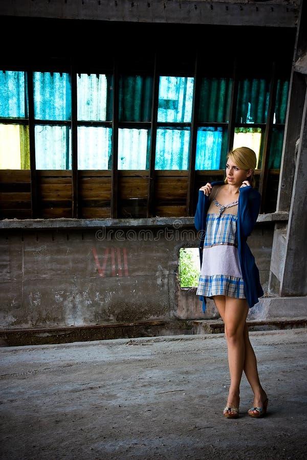 Menina na fábrica velha foto de stock royalty free