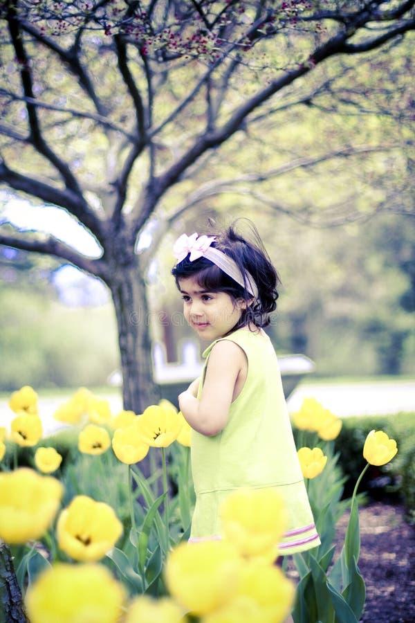 Menina na flor garden9 imagens de stock royalty free