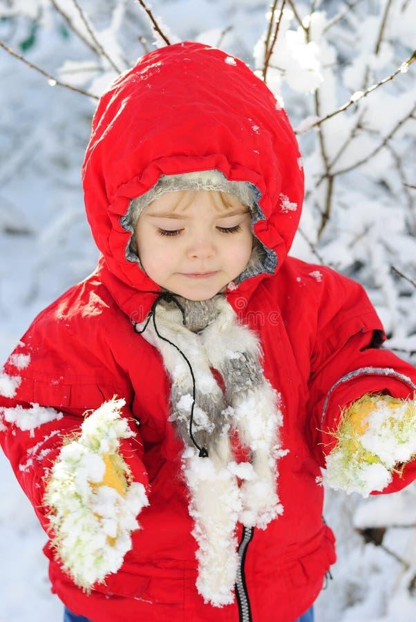 A menina na neve fotografia de stock