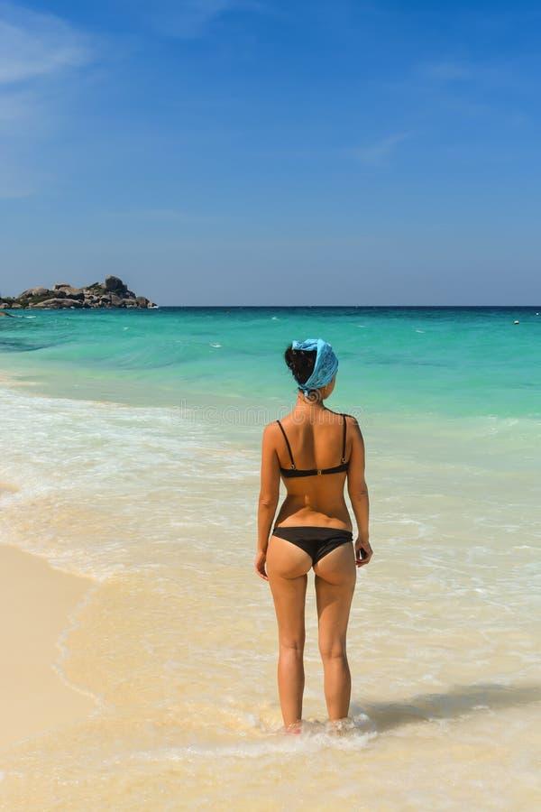 A menina na praia imagens de stock royalty free