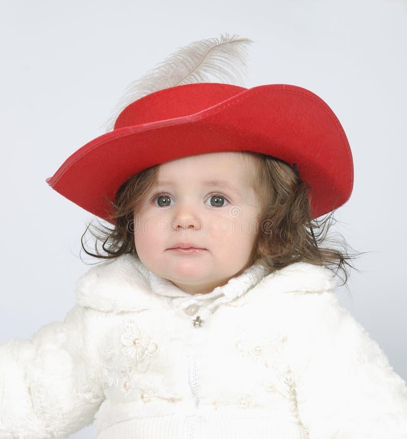 A menina na roupa comemorativo fotografia de stock