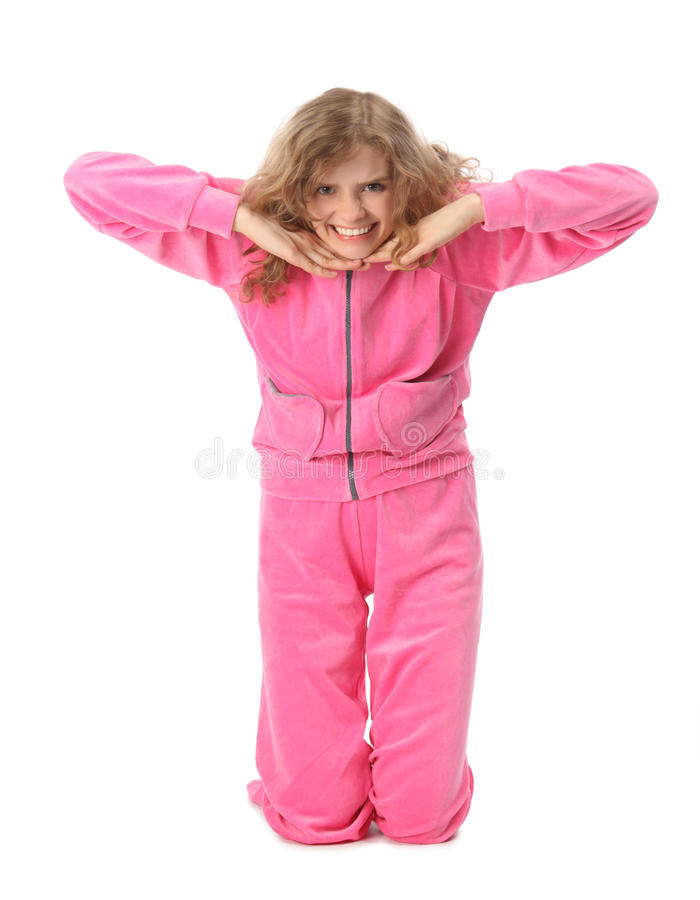 A menina na roupa cor-de-rosa representa a letra t fotografia de stock royalty free