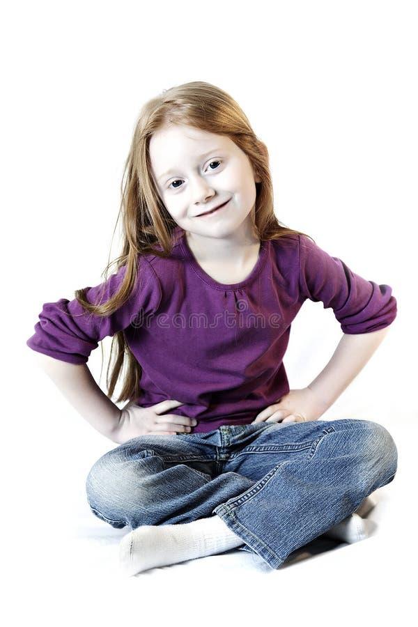 Menina nas calças de brim foto de stock