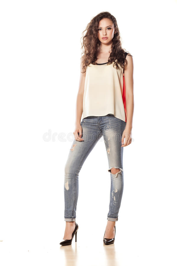 Menina nas calças de brim foto de stock royalty free