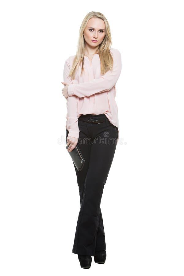 Menina nas calças e blous barreira parcial formada imagem de stock