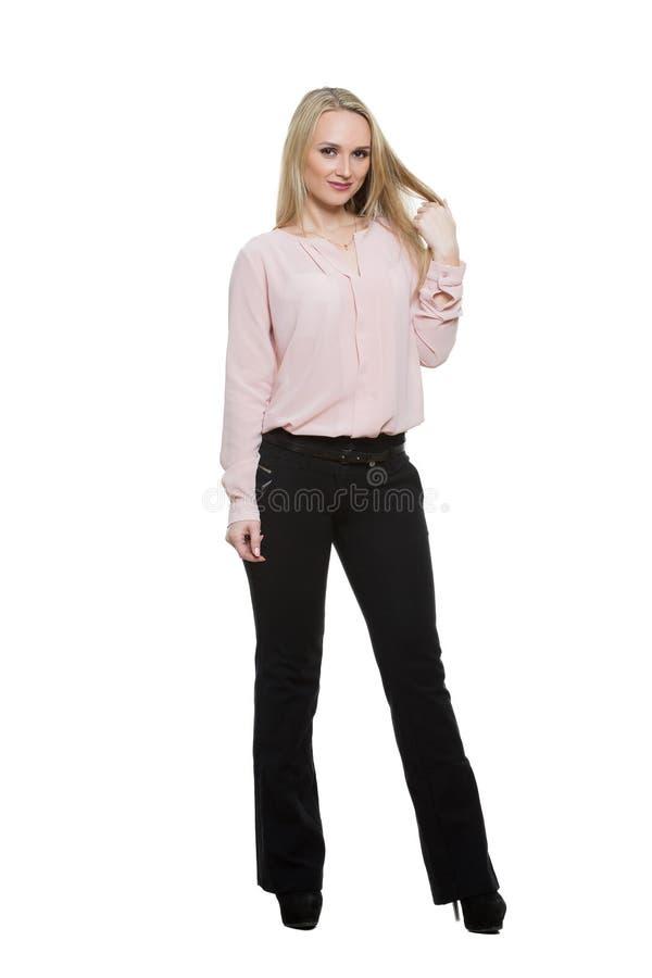 Menina nas calças e blous Isolado no branco foto de stock royalty free