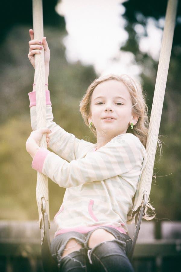 Menina no balanço fotografia de stock royalty free