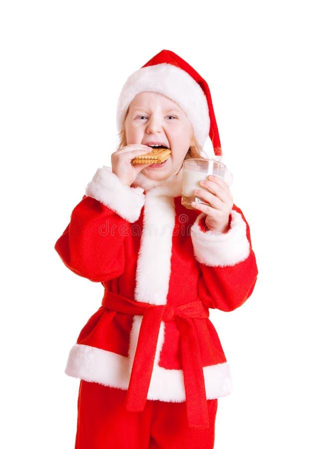 menina no chapéu de Papai Noel imagem de stock