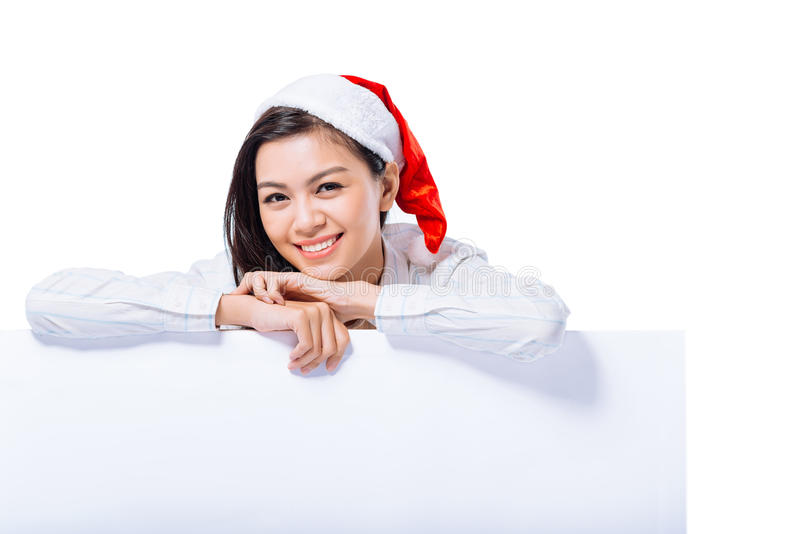 Menina no chapéu de Papai Noel imagens de stock royalty free