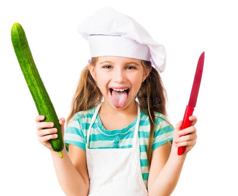 Menina no chapéu do cozinheiro chefe imagens de stock