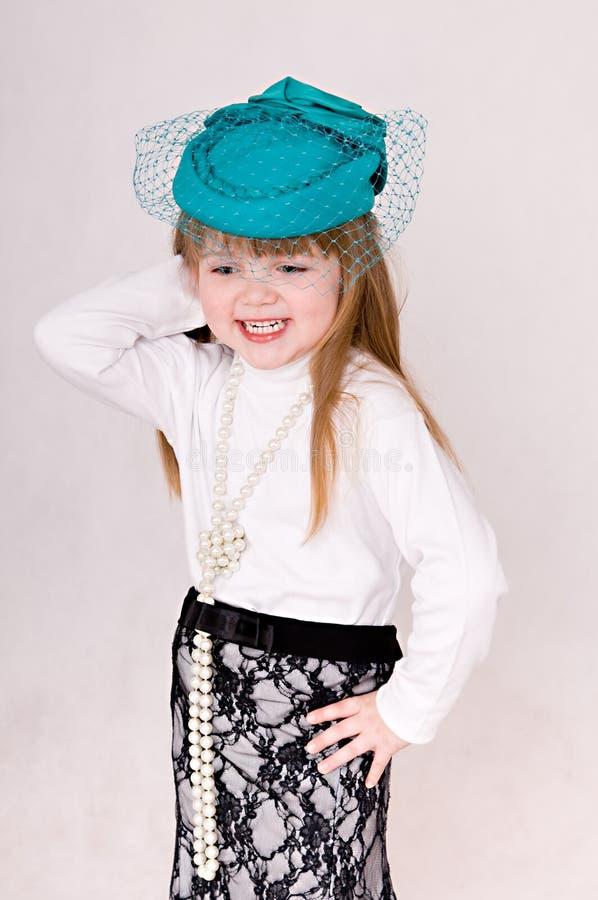 Menina no chapéu verde imagens de stock royalty free