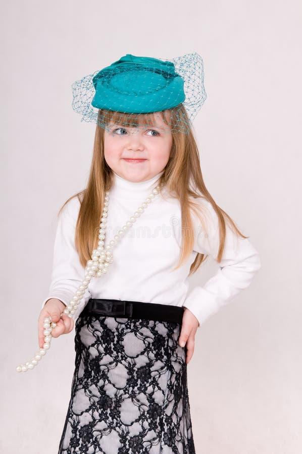 Menina no chapéu verde imagem de stock royalty free